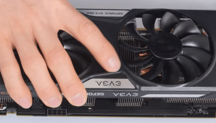 13. Carefully refit the cover of the graphics card.