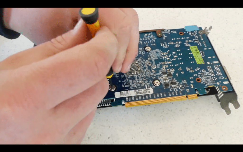 2.2 unscrew the graphics card.