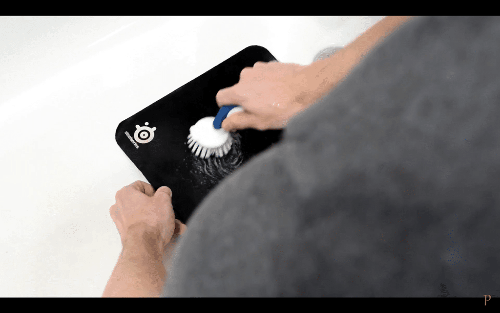 4. brush off the entire area of the mousepad