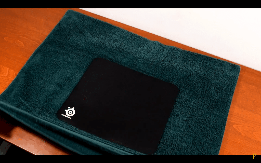 6. Put the mousepad on a towel