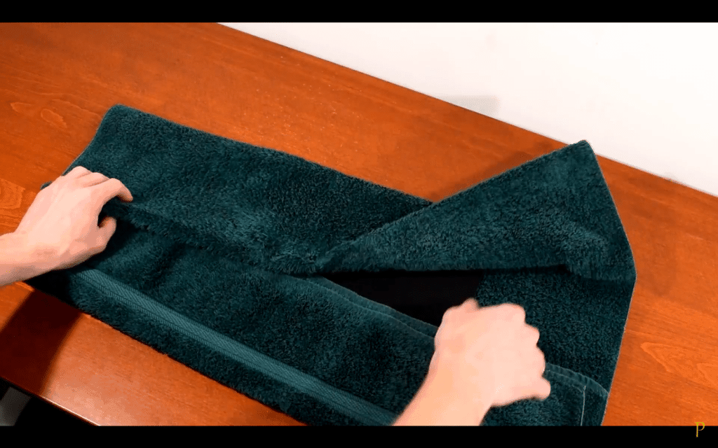 7. Fold the edges of the towel